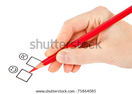 female hand with red pencil choosing yes or no - stock photo