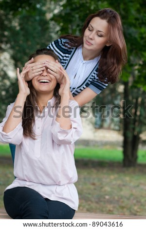 Female student making fun of another female student, European, White, Caucasian - stock photo