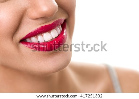 female wide smile with red lips and healthy teeth