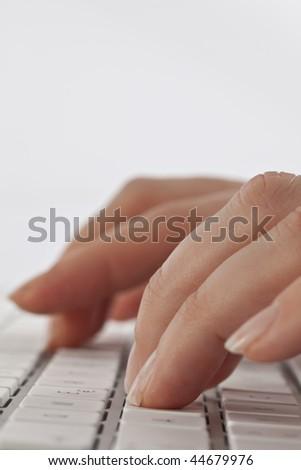 Female working on a keyboard - stock photo