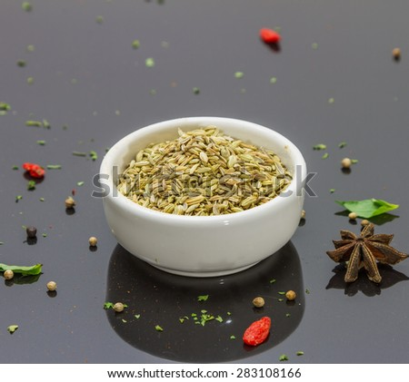 (Fennel seeds) Spices and herbs on tile background, Top view indian spices and herbs difference ware on tile background with copy space for design spices, herbs or foods content.