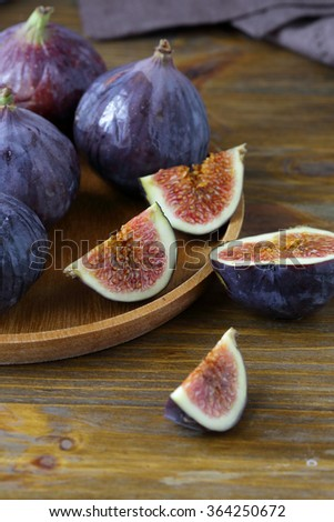 figs on wooden plate, food
