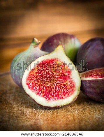 Figs Slice in light on dark wooden background