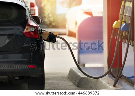 filling gasoline in car with a nozzle.  - stock photo