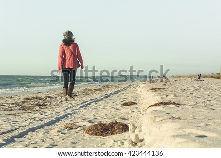 (Film&Instagram Concept): Outdoor recreation at the beach. Walking on the beach is a popular outdoor recreation activity for people. Most of the people do outdoor recreation on weekend.
