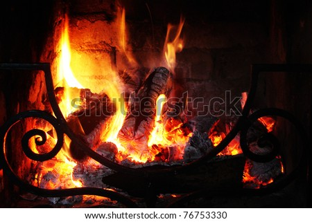 Fire in the fireplace with a lattic - stock photo