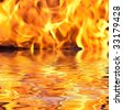 fire reflected in water - stock photo