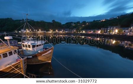 fishing boat at Tobermory quay, Scotland, at dawn - stock photo