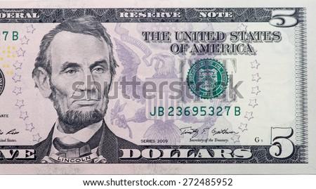 five dollar bill: abraham lincoln - stock photo