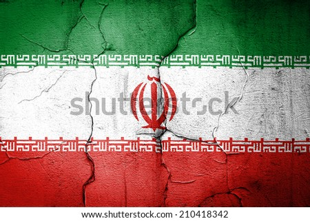 flag of Iran painted on cracked wall - stock photo