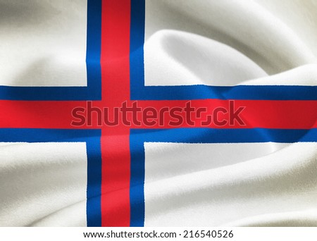 flag of the Faroe Islands waving in the wind. Silk texture pattern