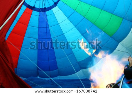 flame seen inside a hot air balloon - stock photo
