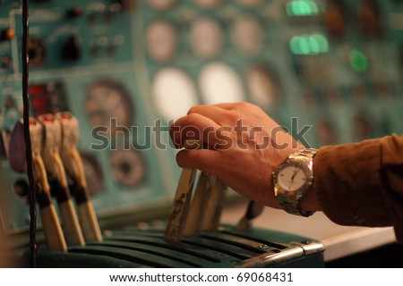 ??? flight engineer holds handle of throttle in the airliner - stock photo
