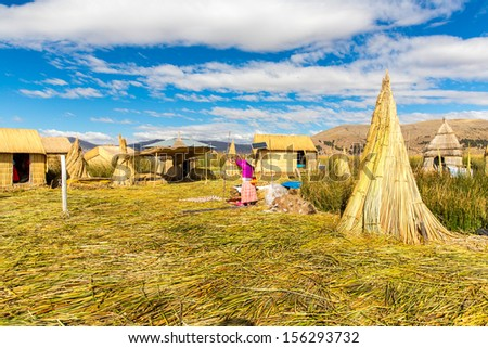 Floating  Islands on Lake Titicaca Puno, Peru, South America. Dense root that plants Khili interweave form natural layer about one to two meters thick that support islands - stock photo