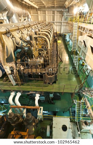 3 - floor high huge engine on board extra large cargo ship - stock photo