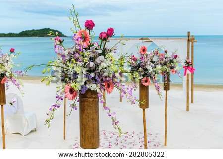flower setting on the beach - stock photo