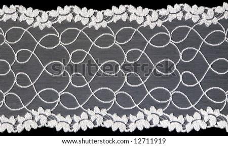 flowered  white lace on black background - stock photo