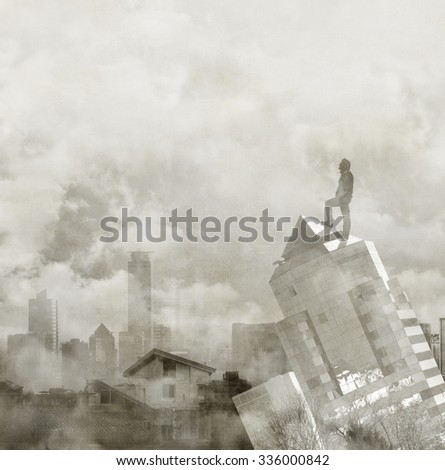 Foggy city skyline with male figure on the top of a building. Concept of global vision. - stock photo