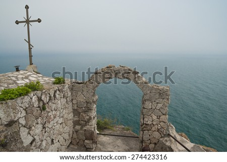 Foggy day spring in the medieval fortress with ancient arch at  Kaliakra headland, Black Sea Coast, Bulgaria - stock photo