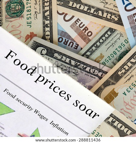 """Food prices soar""  newspaper headlines. Global currency in the background"