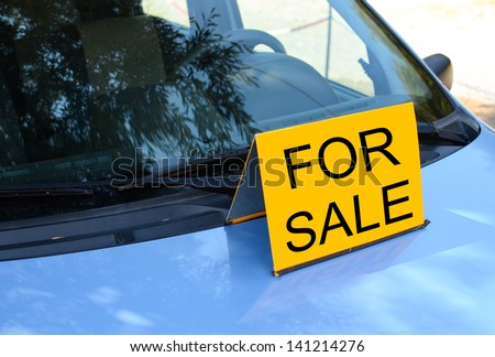 """FOR SALE"" sign on car - Sell a car concept - stock photo"