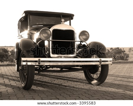 1929 Ford Model A on a countryside background during sunset. Partially white background. - stock photo