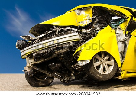 Foreground yellow car accident demolished Cloud sky as a backdrop  - stock photo