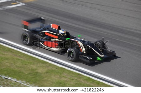 Formula 2.0  race car racing at high speed on speed track with motion blur