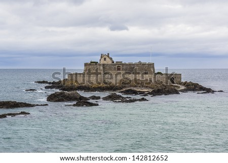 """Fort National"" - fortress on tidal island Petit Be in Saint-Malo. Fort was built in 17th century to protect city. Saint-Malo is a walled port city in Brittany in France on English Channel."