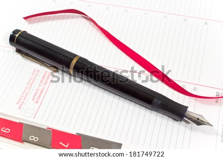 Fountain pen on personal organizer  - stock photo