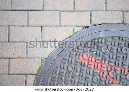 fragment manhole cover in the city - stock photo