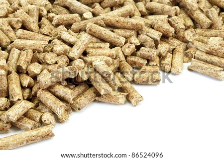 Fragment of  big pile of wood pellets, isolated on white. - stock photo
