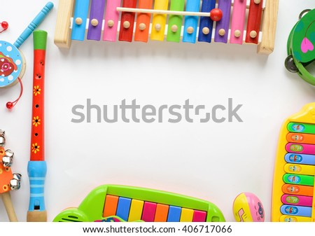 frame made of music accessories for children on white background. Top view.