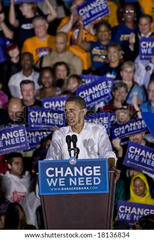 FREDERICKSBURG,VA - SEPT 27: Democratic presidential candidate Barack Obama (R) speaks to supporters while VP candidate Biden looks on at a rally on September 27, 2008 in Fredericksburg, Virginia.