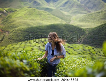 freedom girl in mountains - stock photo