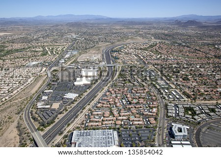 101 Freeway from above with homes and business of northwest Phoenix, Arizona - stock photo