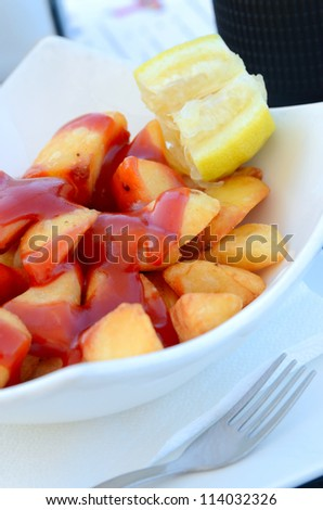 French fry with ketchup in white plate