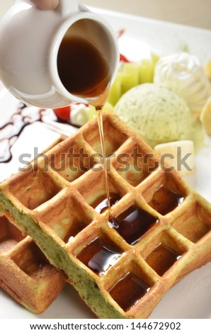 Fresh and delicious waffle with honey