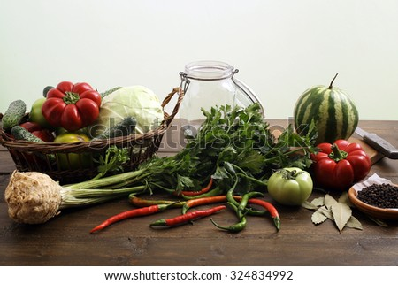 fresh assorted vegetables on rustic table background - stock photo