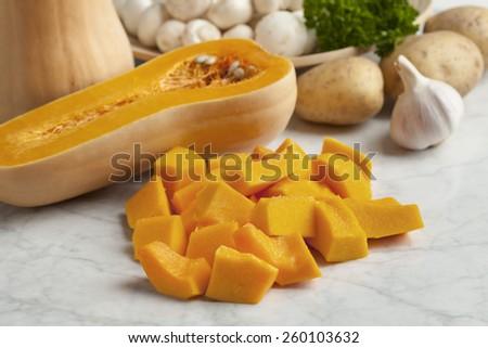 Fresh butternut pumpkin cut into pieces - stock photo