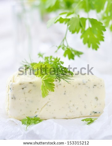 Fresh cheese with  green herbs .Selective focus