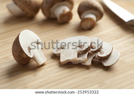 Fresh chestnut mushrooms slices on the cutting board - stock photo