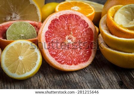 Fresh citrus fruits background - stock photo
