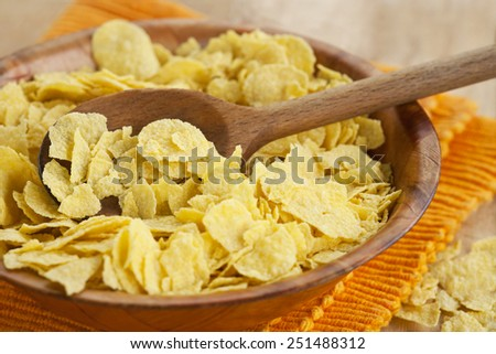 Fresh corn flakes in bowl - stock photo