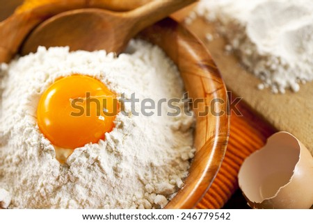 fresh eggs and flour - stock photo
