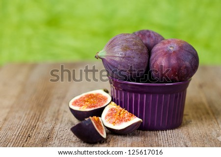 fresh figs in a bowl on rustic wooden table