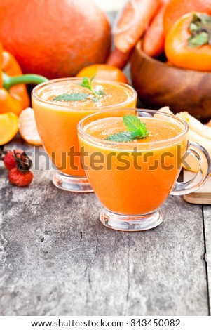 fresh healthy pulpy cocktail with orange fruits and berries and vegetables - stock photo
