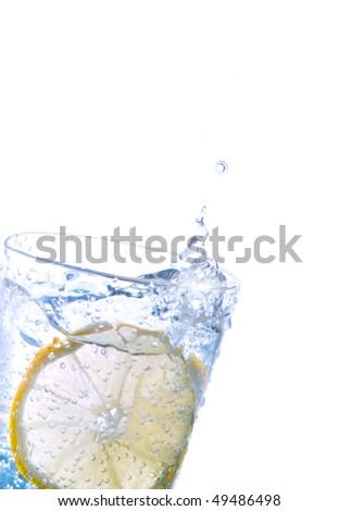 Fresh lemon in sparkling water - stock photo