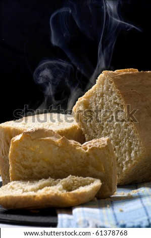 fresh loaf of bread and a bread oven - stock photo