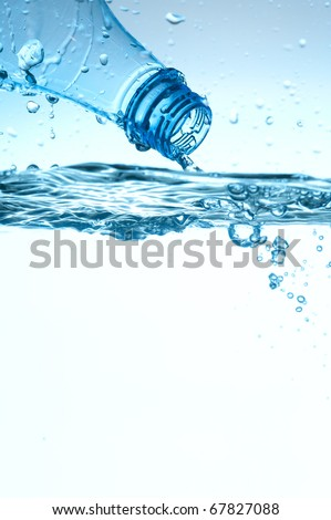 Fresh mineral water with blue bubbles - stock photo